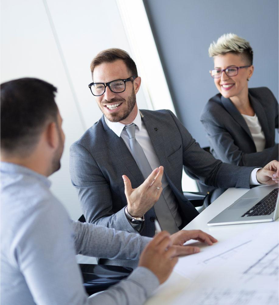 Investors sitting at table having a pleasant conversation